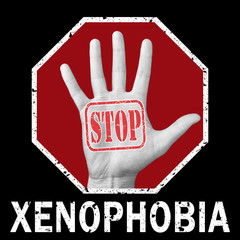 Open hand with the text stop xenophobia. Global social problem