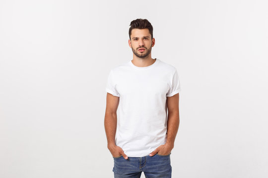 Portrait of smiling young man in a white t-shirt isolated on white background.
