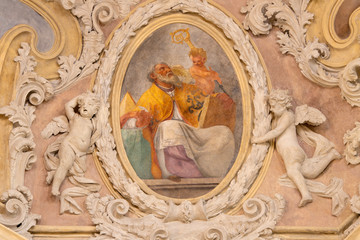 Wall Mural - RIVA DEL GARDA, ITALY - JUNE 13, 2019: The baroque fresco of St. Ambrose doctor of the west catholic church in church Chiesa di Santa Maria Assunta  by Teofilo Polacco from beginn of 19. cent..