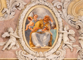 Wall Mural - RIVA DEL GARDA, ITALY - JUNE 13, 2019: The baroque fresco of St. Augustine doctor of the west catholic church in church Chiesa di Santa Maria Assunta  by Teofilo Polacco from beginn of 19. cent..