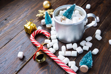 Christmas marshmallows and new year decorations on wood background. Winter holidays, New Year mood