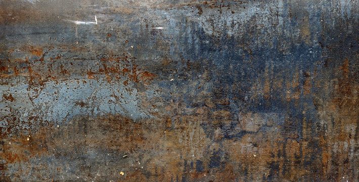 rusty metal surface with red, black and orange tones - worn steampunk background with scratches
