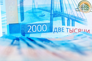 New cash banknotes of Russia with the image of the Crimean bridge, face value of 2000 rubles. Inflation and devaluation. Historical money. Salary and remuneration.