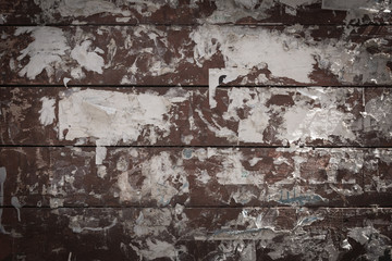 Old painted brown wooden background with glue and paper close up