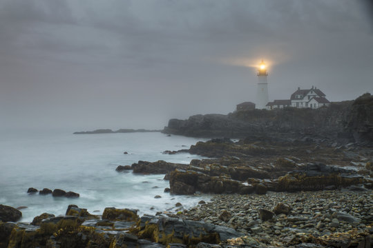 lighthouse in heavy fog