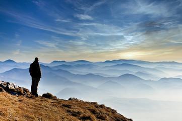 Foto auf Acrylglas Beige Landscape view of misty mountain hills and man silhouette, Slovakia