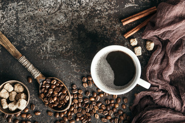 Wall Mural - Coffee board with coffee beans on dark textured background.