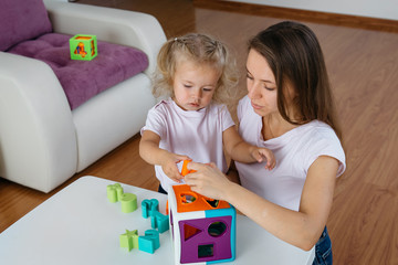 Child learning colors, letters and improve fine motor skills