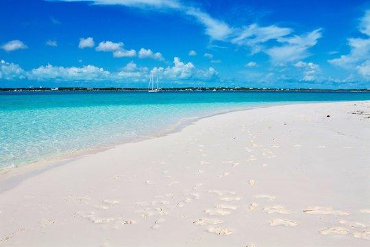 Exotic tropical beach landscape with white sand beach and amazing turquoise sea water. Summer holiday vacation concept. Amazing travel destination. Stocking island, Exuma, Bahamas