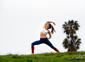 Physically Fit Woman Stretching Outdoors
