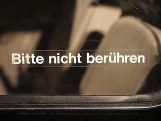 Bitte nicht beruehren (translation: Please do not touch) label