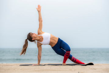 Healthy Woman Stretching on Beach