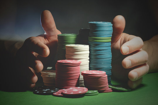 Male hands and poker chips close up. Prize of the winner or all in concept.