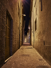 Foto op Plexiglas Smal steegje Rimini, Emilia Romagna, Italy: narrow alley at night in the old town