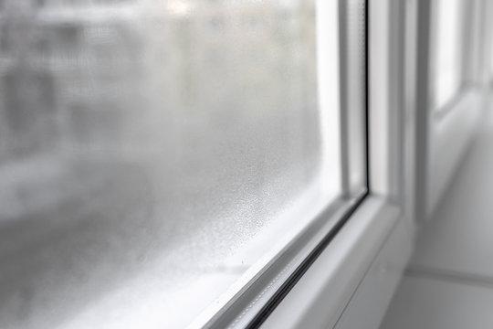 Water condensation on PVC windows during autumn. Plastic window.