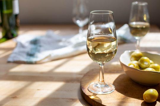 Sherry wine tasting, dry fino, manzanilla or palomino jerez fortified wine in glasses, Jerez de la Frontera, Andalusia, Spain