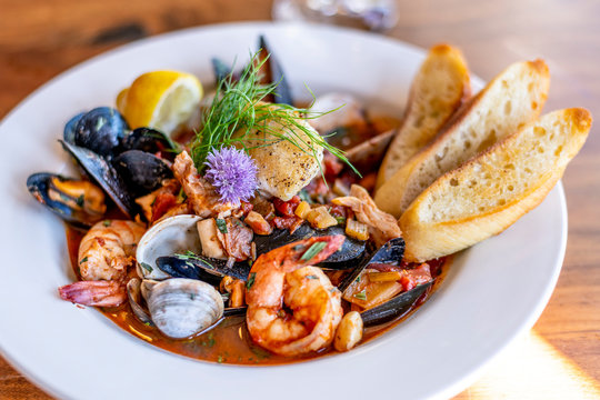 Bouillabaisse Seafood Soup Close-Up with Shrimp, Muscles, Clams, Fish, Fennel and Grilled Bread