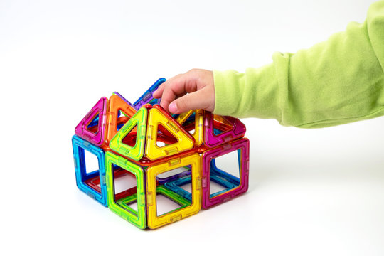 Magnetic toys on white background.