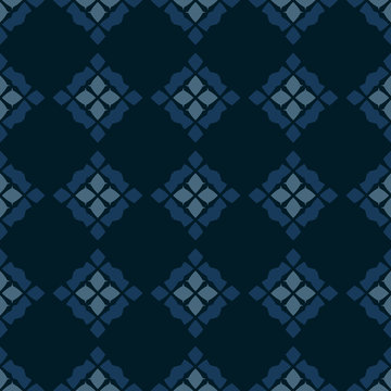 Vector geometric seamless pattern. Traditional folk ornament. Texture with rhombuses, flower silhouettes, diamonds. National ethnic motif. Black, blue and teal colors. Repeat ornamental background
