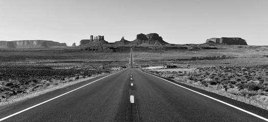 The desert landscape of Monument Valley, Navajo Tribal Park in the southwest USA in Arizona and...