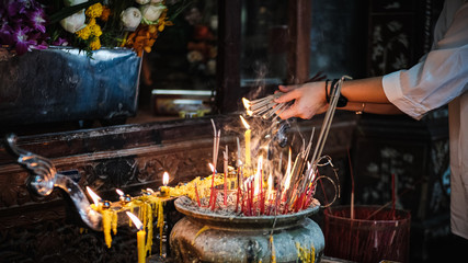 Incense burning Embossed and smoke in the pot during praying in a pot , Incense for praying Buddha gods to show respect at temple.