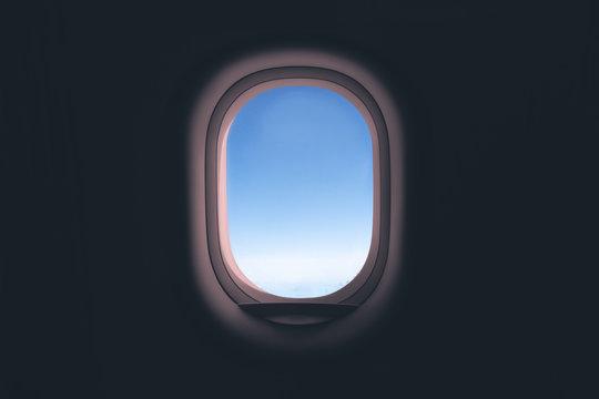 Airplane window. Glass in focus sky blurry