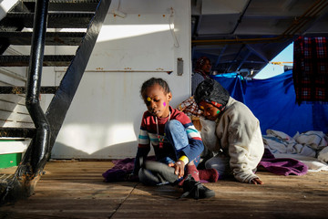 Fatima and Ibrahim rest on board of NGO Proactiva Open Arms rescue boat in central Mediterranean Sea