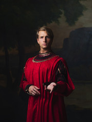 handsome man in a Royal red doublet