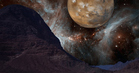 Composite image of the rocky desert in Jordan with unreal background of a star nebula and the planet Mars. Elements of this image furnished by NASA