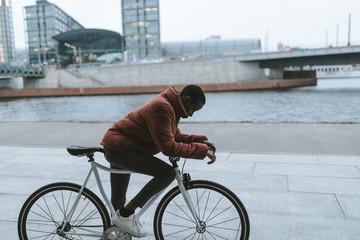 woman on bicycle on promenade