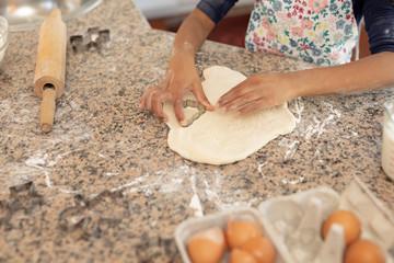 Girl making Christmas cookies at home