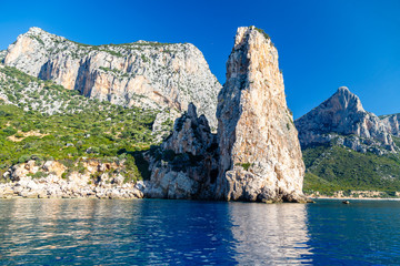 The monolith of Pedra Longa, Baunei, province of Ogliastra, East Sardinia, Italy. The rocky spire which rises majestically out of the sea. Holidays in Sardinia.