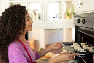 Woman making Christmas cookies at home