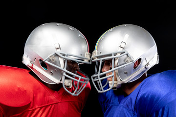 Two American football players head to head