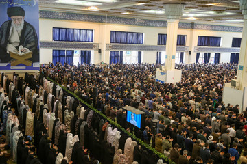 Worshippers pray during the Friday prayers in Tehran