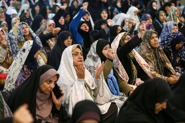 Women pray during the Friday prayers in Tehran