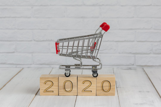 trolley on 2020 new year block ,  shopping concept
