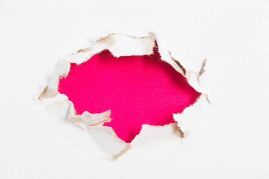 hole in white paper with colored paper backing