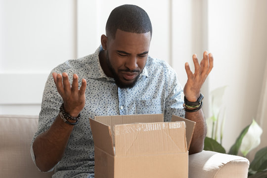 Confused biracial male open package get wrong order