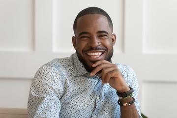 Portrait of smiling biracial man look at camera laughing