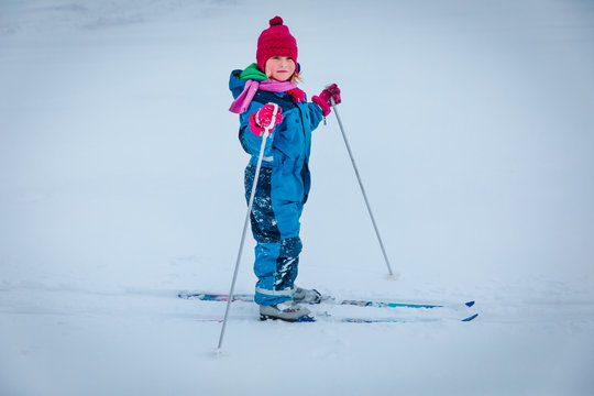 little girl ski in winter nature, kids active lifestyle, winter sport
