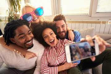 Two couples making funny selfie