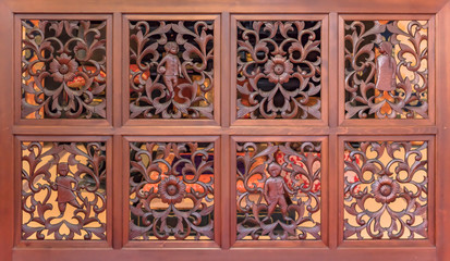 Decorative carvings wood panel with flowers patterns and asian children characters in the choanji temple.