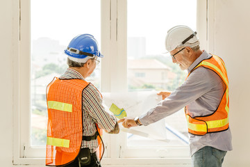 Happy professional worker working together home builder architecture mix race in construction site