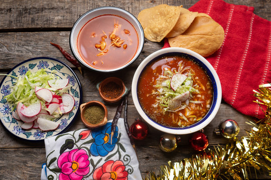 Mexican red pozole with christmas decoration on wooden background