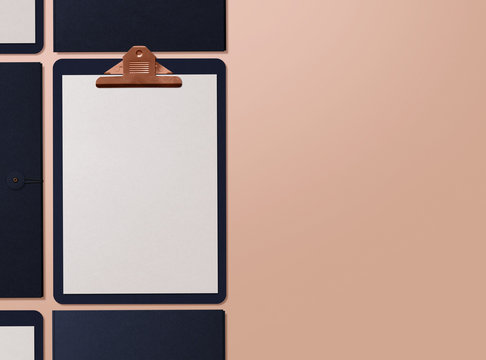 Realistic mockup. Clipboard with sheets of paper on nude background. Template for branding identity. Blank objects for placing your design. 3D illustration.