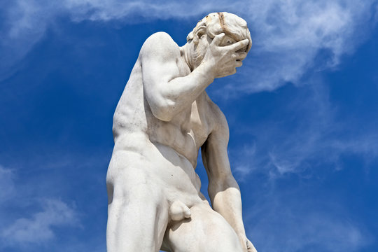 View of the marble sculpture Cain after killing his brother Abel (1896) by Henri Vidal (1864-1918) in the Tuileries Park, Paris, France.