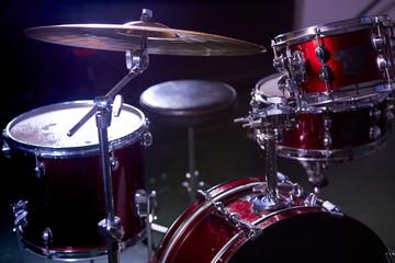 professional drum set instruments in dark studio with lights . music, instruments, hobby concept