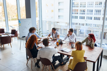 Business co-workers work together in business office, conference office, wearing formal wear and sit discussing. Caucasian business people