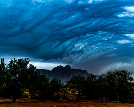 A storm approachring the Superstition Mountains